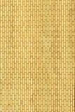 黄色墙壁由背景和纹理的砖制成 免版税库存图片
