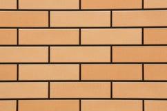 黄色墙壁铺磁砖背景 免版税库存照片