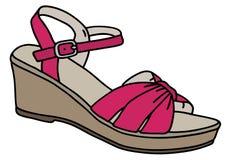 紫色妇女的凉鞋 免版税图库摄影