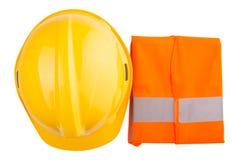 黄色安全帽和橙色背心v 免版税图库摄影