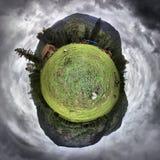 绿色小的行星 免版税库存图片