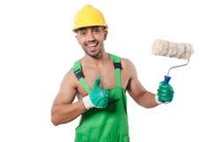 绿色工作服的画家 库存图片