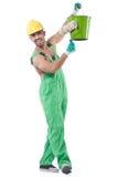 绿色工作服的画家 免版税库存图片