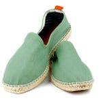 绿色帆布鞋 图库摄影