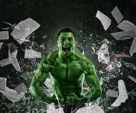 绿色强有力的肌肉人 免版税库存图片