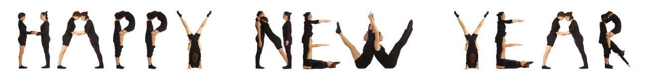 黑色形成新年快乐词的加工好的人民 免版税库存图片