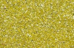 黄色抽象背景 金子闪烁特写镜头照片 金黄淡光包装纸 免版税库存图片