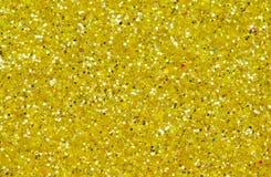 黄色抽象背景 金子闪烁特写镜头照片 金黄淡光包装纸 图库摄影