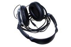 黑色拔去了在白色背景隔绝的耳机 免版税库存图片