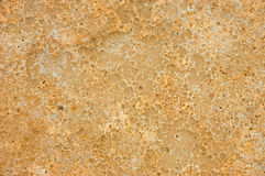 黄色挖坑的和被风化的砂岩背景纹理 库存照片