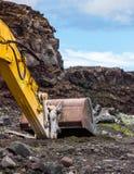 黄色挖掘机 免版税图库摄影