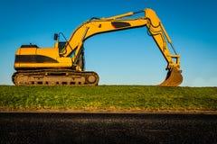 黄色挖掘者 库存照片