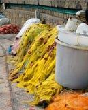 黄色捕鱼网在克利特海岛上的港口 图库摄影