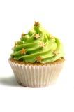 绿色提取乳脂的甜杯形蛋糕 免版税库存图片