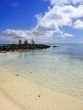 黑色日横向毛里求斯海运向晴朗扔石头 毛里求斯 免版税库存图片