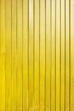 黄色木板条墙壁纹理背景 库存照片