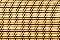 从黄色木竹棍子的席子有棕色螺纹的 库存图片
