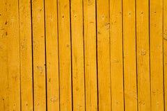 黄色木背景 免版税库存图片