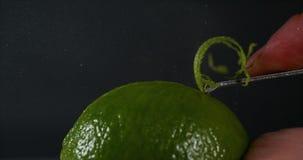 绿色柠檬味,柑橘aurantifolia,反对黑背景, 影视素材