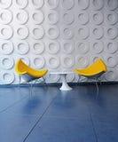 黄色椅子和表在风格化屋子里 免版税库存照片
