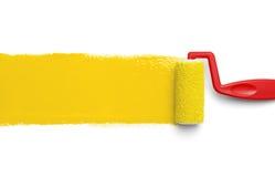 黄色漆滚筒 免版税库存图片