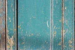 绿色灰色油漆呈杂色的木门 免版税库存照片