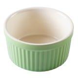 绿色烘烤盘杯形蛋糕倒空被隔绝的特写镜头 免版税图库摄影