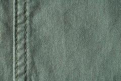 绿色牛仔裤 免版税库存照片
