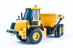 黄色玩具卡车 免版税库存照片