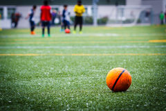 水色球取火镜足球 免版税图库摄影
