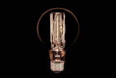 黑色电灯泡白炽光 库存照片
