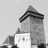 黑色白色 被加强的撒克逊人的中世纪教会Homorod,特兰西瓦尼亚 免版税库存图片