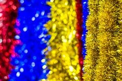 色的圣诞节闪亮金属片 库存照片