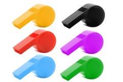 色的塑料口哨 库存照片