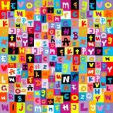色的字母表在模式上写字 免版税库存图片
