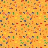 色的字母表在模式上写字 库存照片