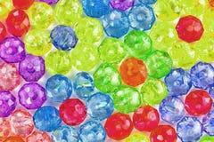 色的小珠背景,花背景由色的小珠做成 免版税图库摄影