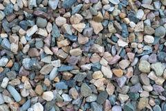 色的小石头美好的纹理,石头背景  库存照片