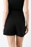 黑色的少妇短缺和衬衣 免版税图库摄影