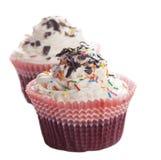 色的杯形蛋糕与巧克力片和洒 库存图片