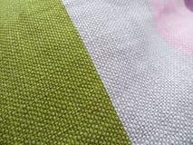 色的棉花枕头 库存照片
