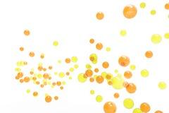 黄色的气泡和桔子被隔绝的背景 免版税图库摄影