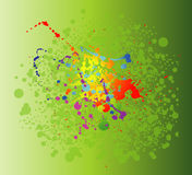 色的油漆在绿色背景飞溅隔绝 库存照片