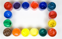 色的油漆瓶子框架 库存图片