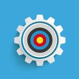 色的目标齿轮蓝色背景 免版税库存照片
