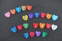 色的石心脏,德国文本Guten Rutsch Ins Jahr 2018意味新年快乐2018年 库存照片