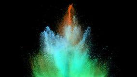 色的粉末爆炸在黑背景的 库存图片