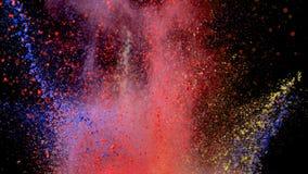 色的粉末爆炸在黑背景的 库存照片