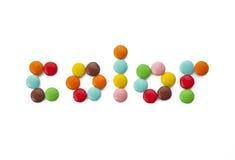 色的糖果巧克力上色水多的politra 免版税图库摄影