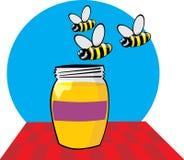 色的蜂蜜瓶子 免版税图库摄影